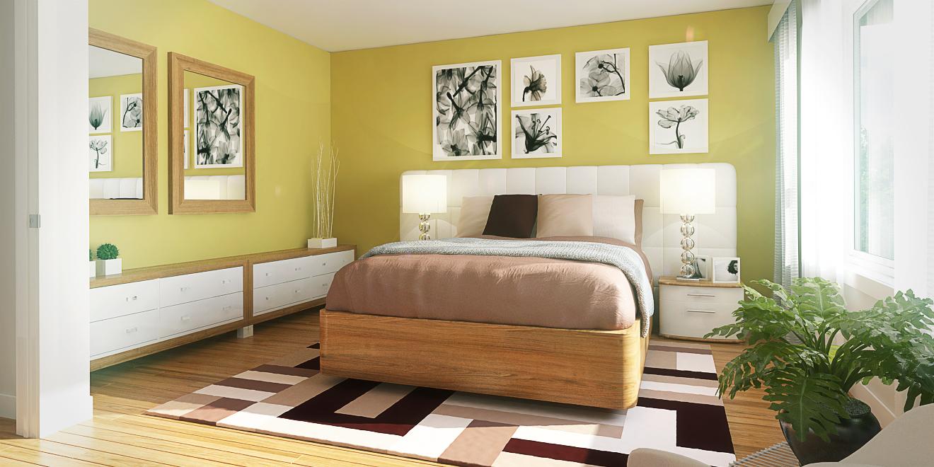 Chambre à coucher avec mur peinturé de couleur jaune Ochre Gold