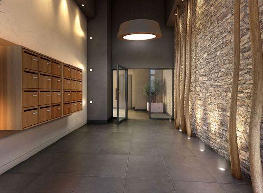 Hall d'entrée d'un immeuble à logement avec boite aux lettres communes
