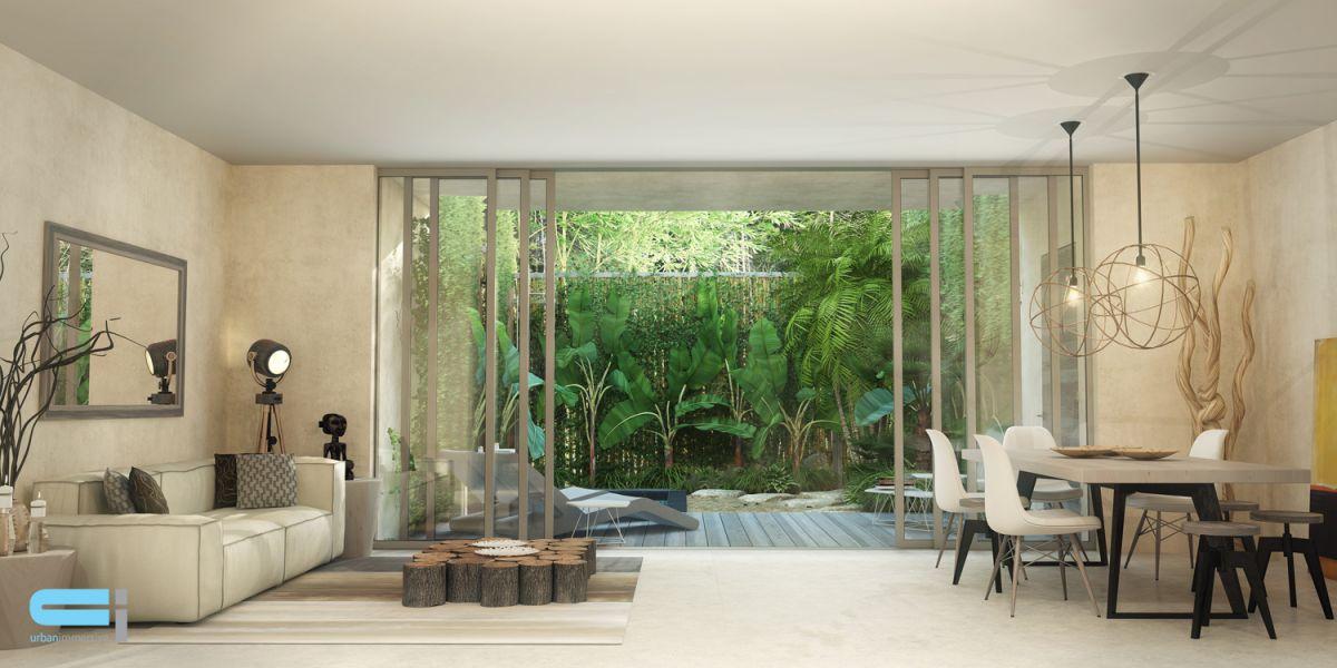 Magnifique salon/salle à manger avec porte patio donnant sur cour abondante de verdure. Un oasis de nature dans sa cour.