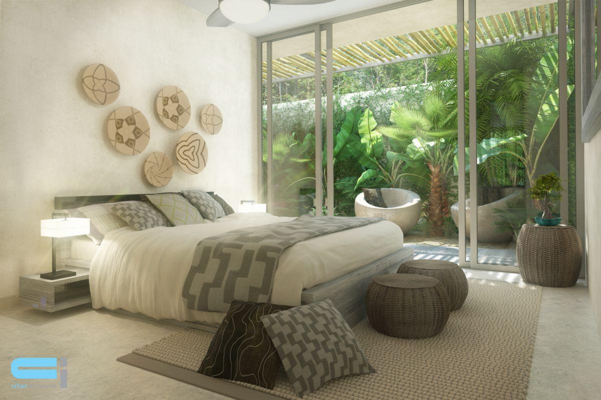 Chambre à coucher donnant sur une cour décorée de végétation abondante.