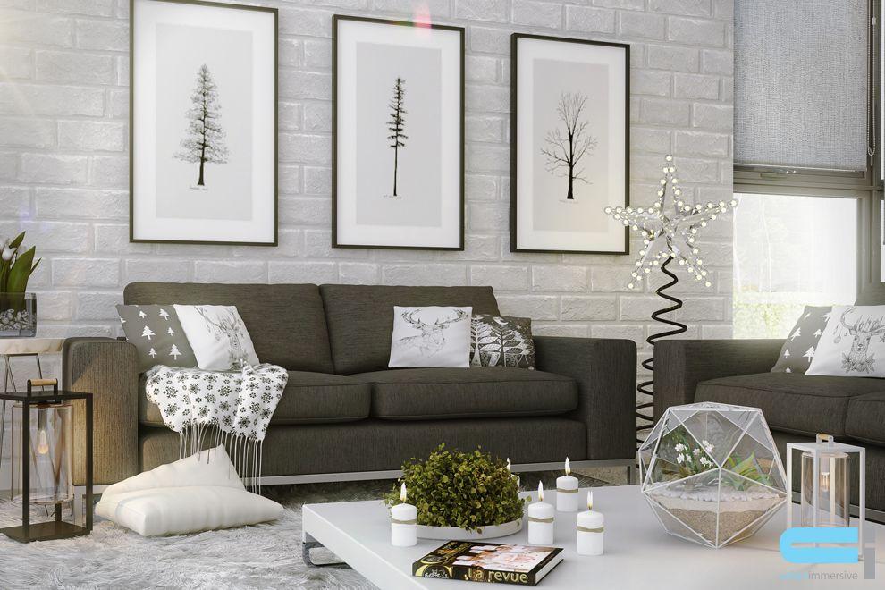Salon de style scandinave avec cadre blanc et noir sur mur de fond